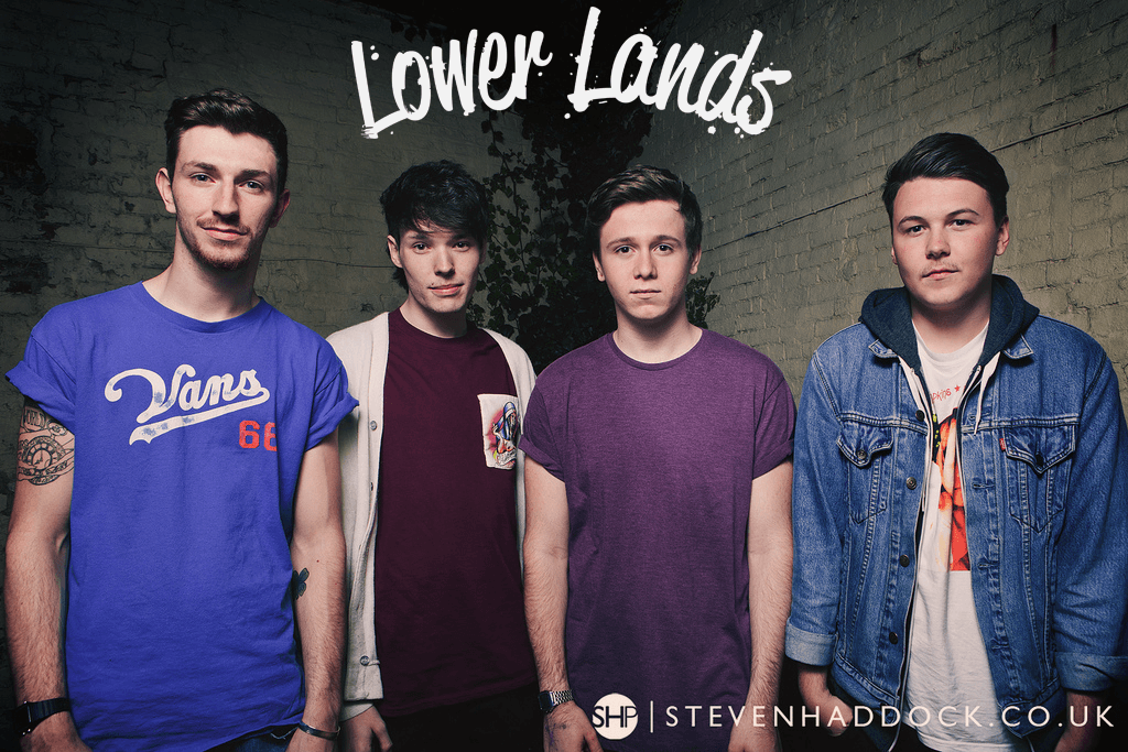 The four guys from Lower Lands stand in a line, facing the camera, and their logo has been imposed above their head.