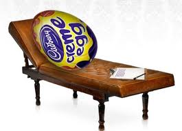 cadbury creme egg lies on a therapists bed