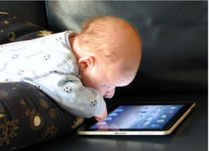 image of baby with ipad from http://proservicescorp.com/wp-content/uploads/ipad_baby.jpg