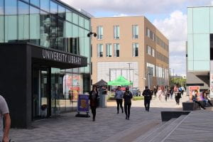 Students walking outside University of Lincoln Library