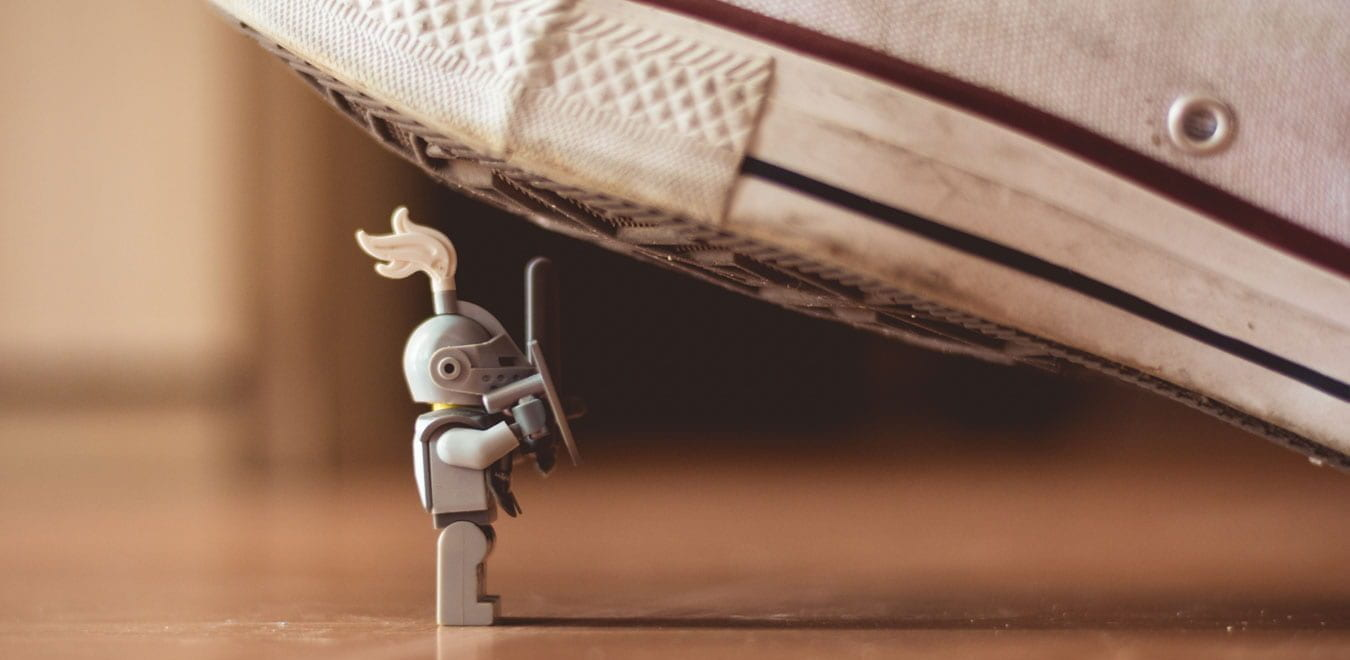 Close up shot of a lego knight almost being stepped on by a converse shoe