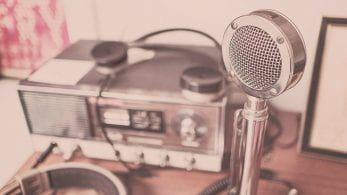 Old fashioned microphone connected to a radio.