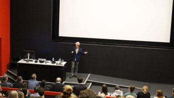 John Hegarty presenting in a lecture theatre.