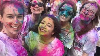 Group of students taking part in the colour run 2017, covered in paint.