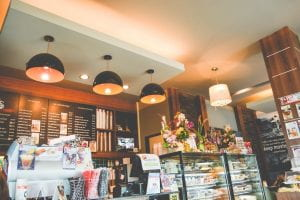 Coffee shop with counter and low hanging lights