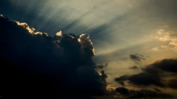 A cloudy sky with light rays