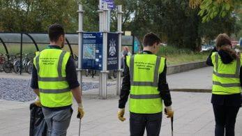 Group of people in hi-vis litter-picking