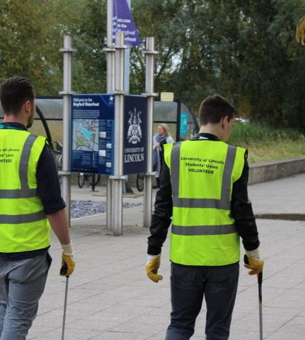 Group of people in hi-vis litter-picking
