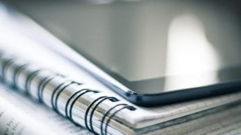 Close up of a notebook with an iPad