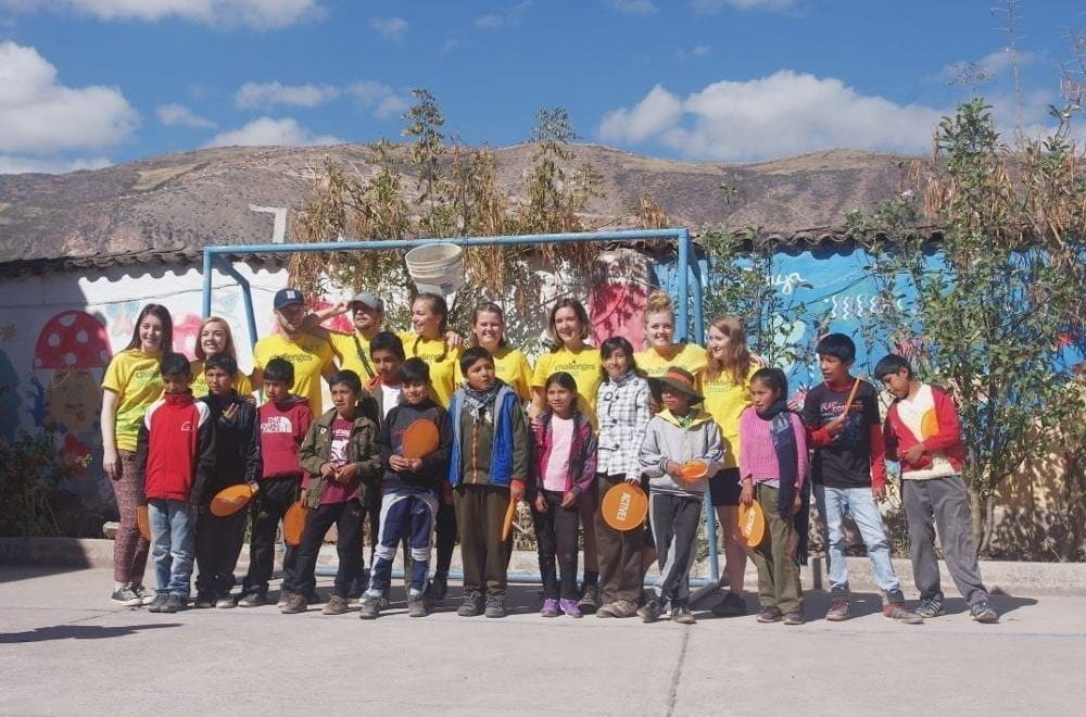 Group of young students and volunteer teachers in Peru.