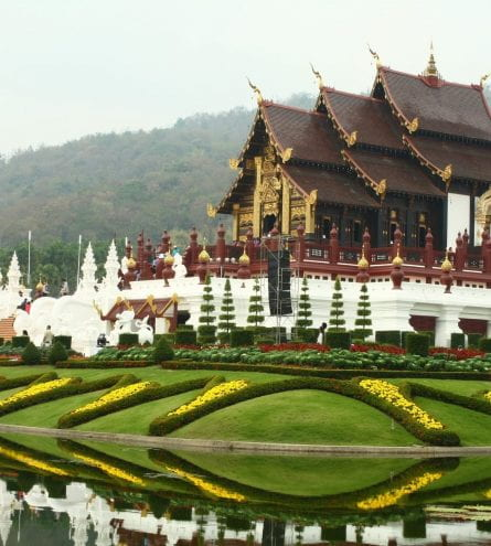 temple with garden and golden arches and trees