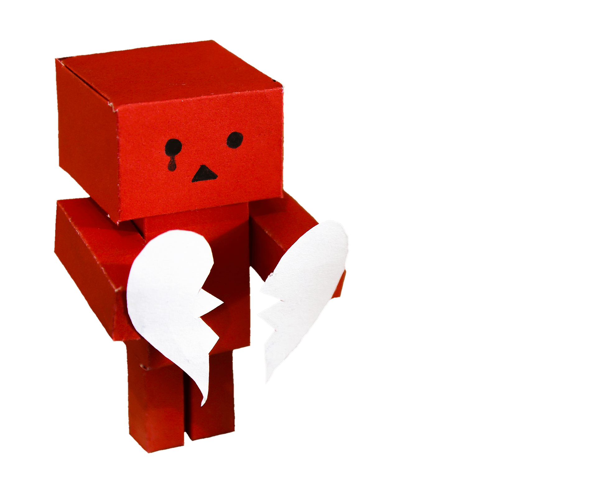 Red cardboard person, holding a broken heart.
