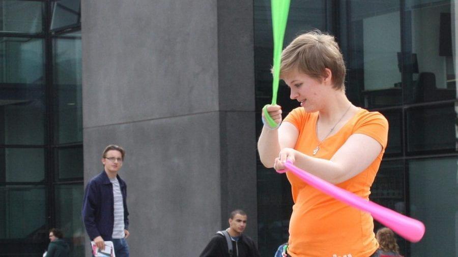 Woman juggling.