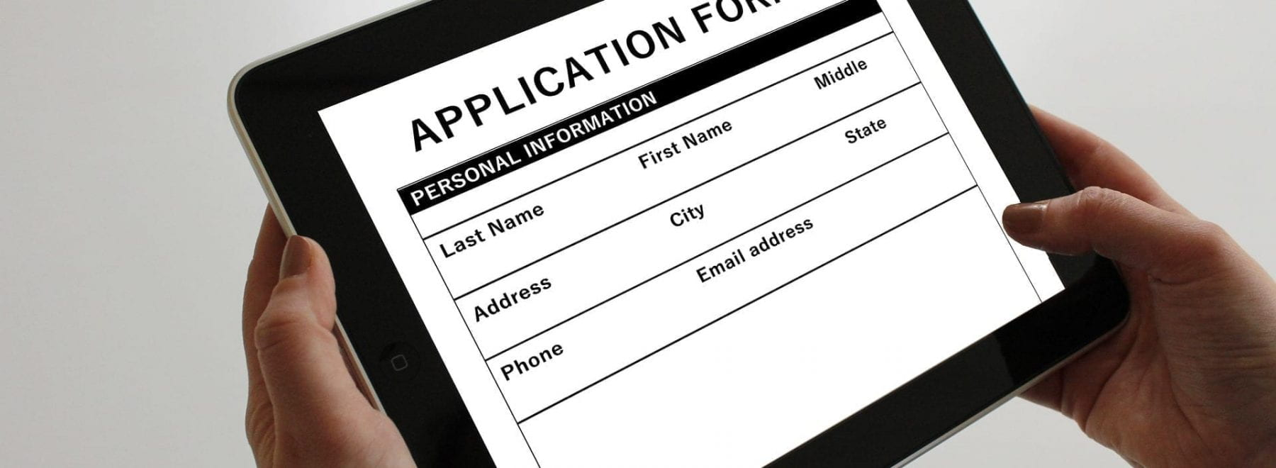 ipad with application form on it