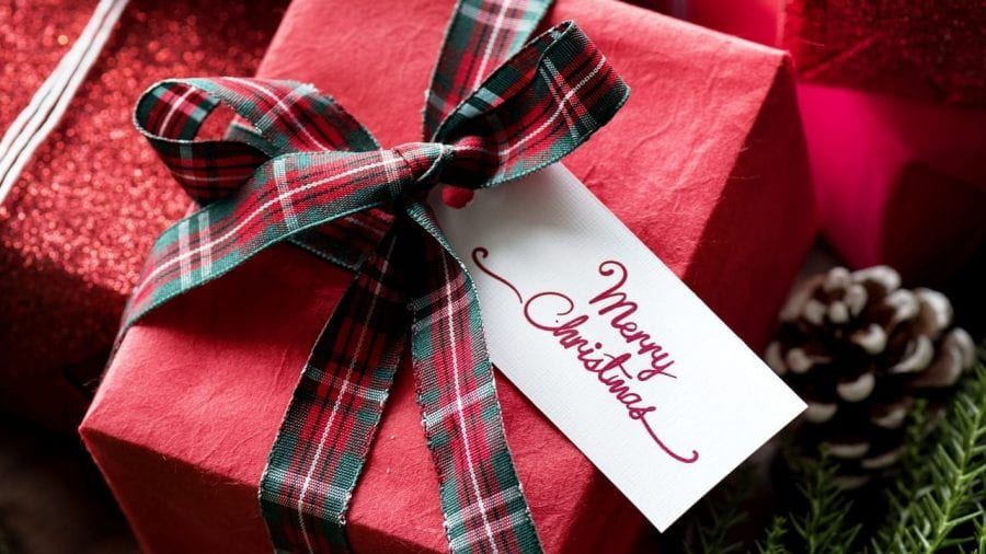 Christmas presents wrapped in red wrapping paper and ribbon.