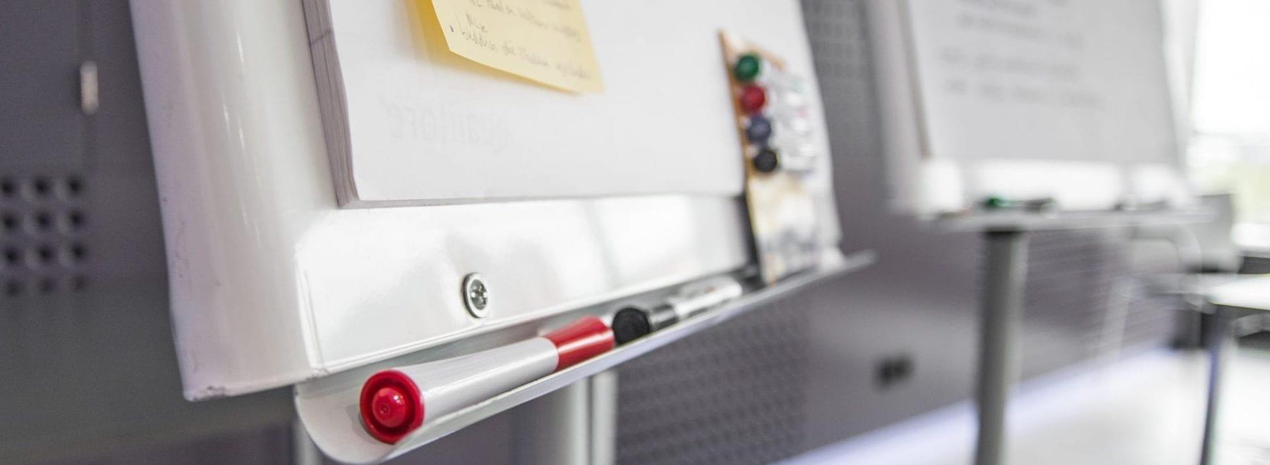 whiteboard, pens, sticky notes