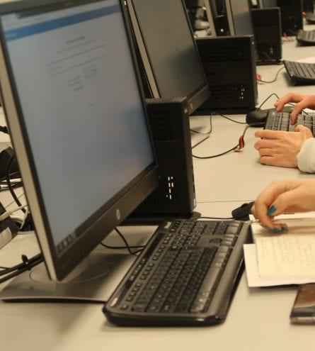 computers, people working, pen, paper, phones