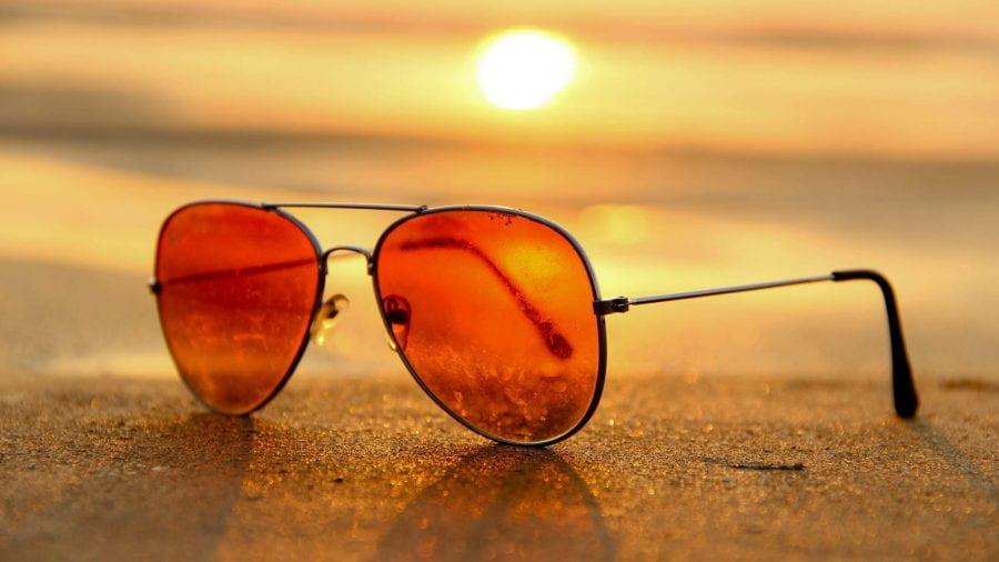 sunglasses on a beach at sunset