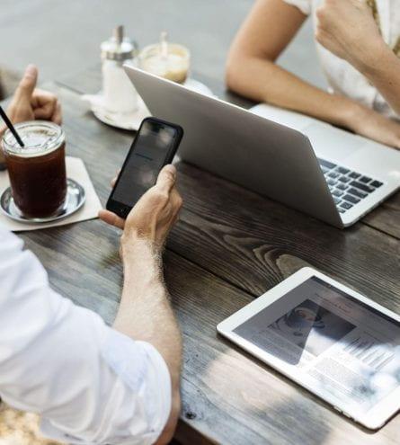 laptop, ipad, phone, coffee, two people relaxing