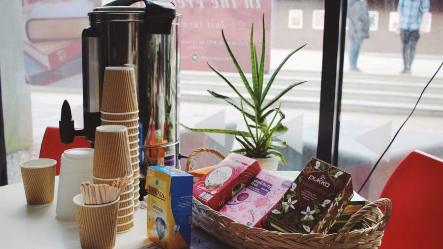 Some cups, herbal teas and a water boiler