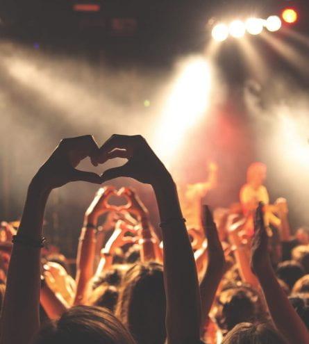 concert, hands up. Hands making a love heart