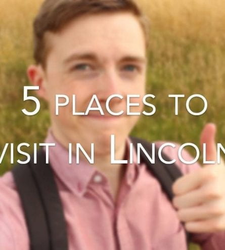 A young man stands in a field and holds his thumb up to the camera with the caption '5 Places to visit in Lincoln'
