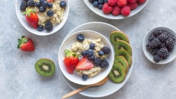 Bowls of fruit and porridge