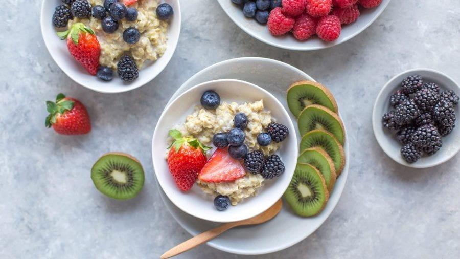 Bowls of fruit and porridge