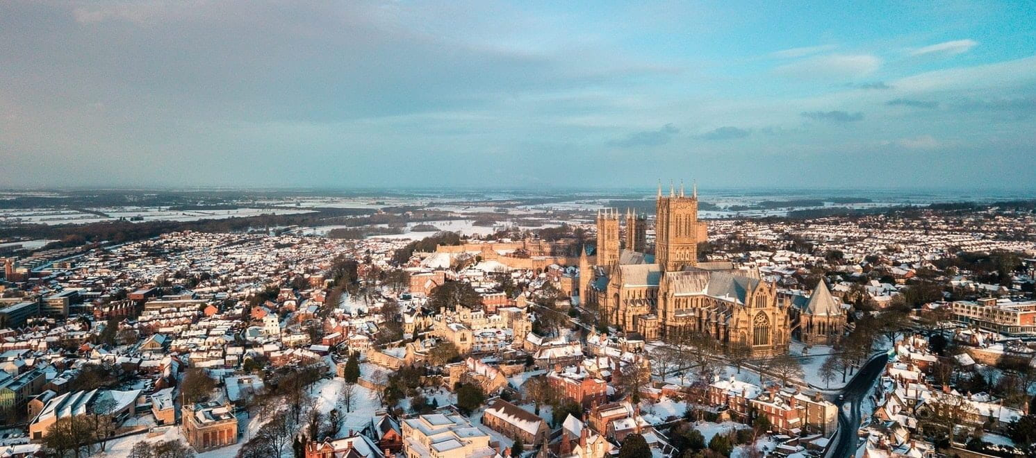 A Birdseye view of the city of Lincoln covered in snow
