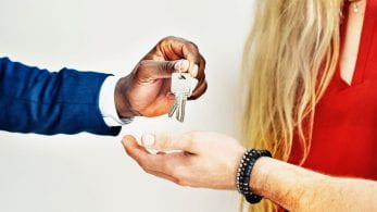 Man handing keys over to tenant.