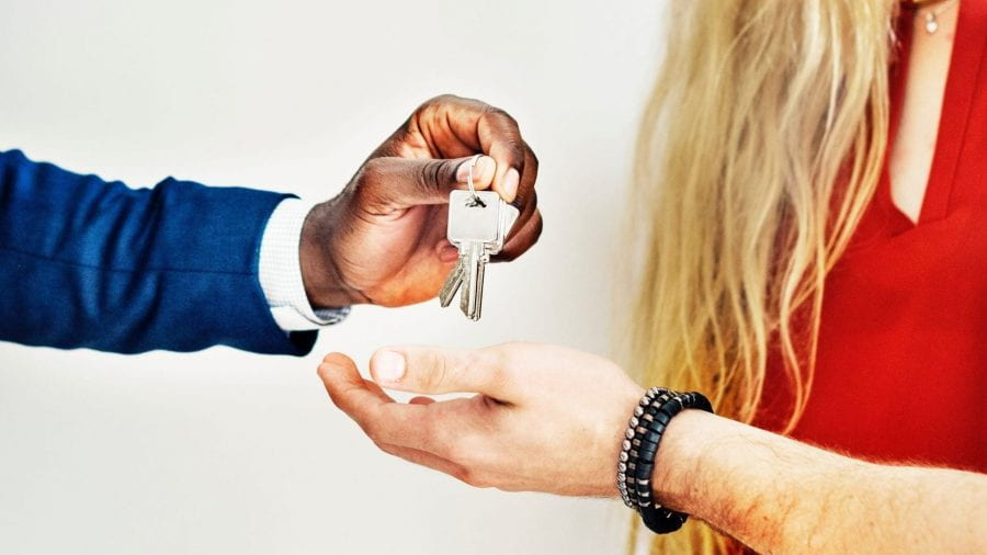 Man handing keys over to tenant.