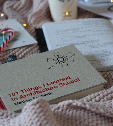 101 Things I learned in Architecture School book on a bed next to a notebook and a candy cane