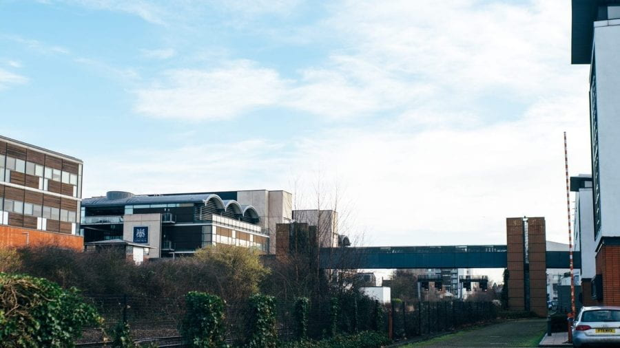 Photo of some of the University of Lincoln's buildings on campus on a bright day