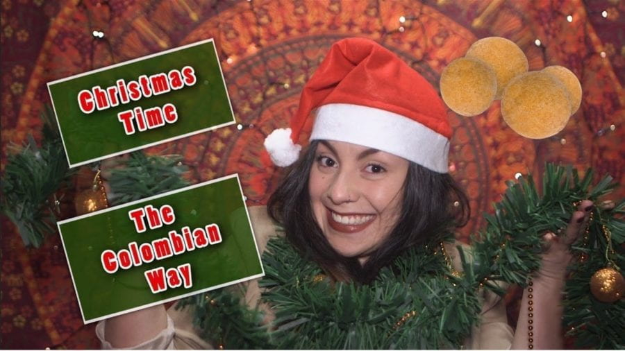 Thumbnail of a girl smiling, wearing a Christmas hat, holding tinsel, saying 'Christmas time the Colombian Way'