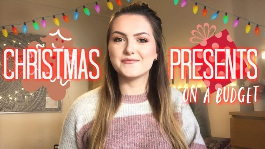 Thumbnail of a girl smiling, with a graphic of Christmas lights, saying 'Christmas presents on a budget'