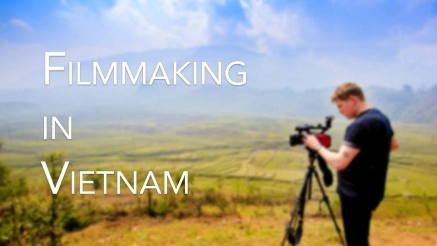 A man filming in the mountains, saying 'Filmmaking in Vietnam'