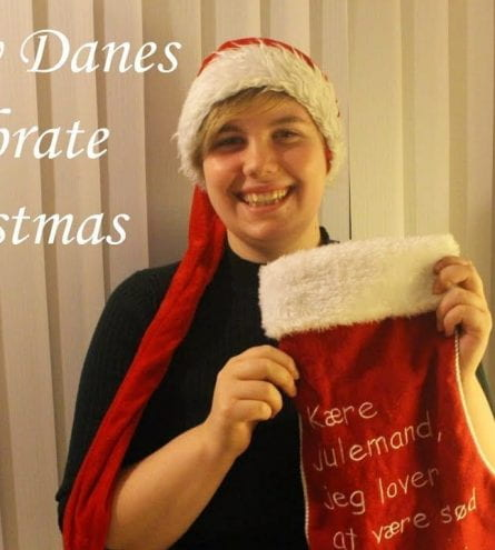 Thumbnail of a girl smiling holding a Christmas stocking and a hat, saying 'How Danes celebrate Christmas'