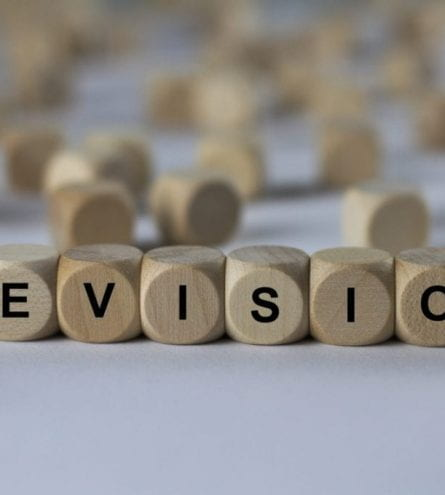 The word 'Revision' spelt out with letter blocks