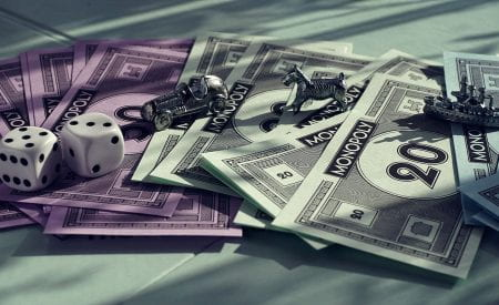 Board game play pieces, money, and dice