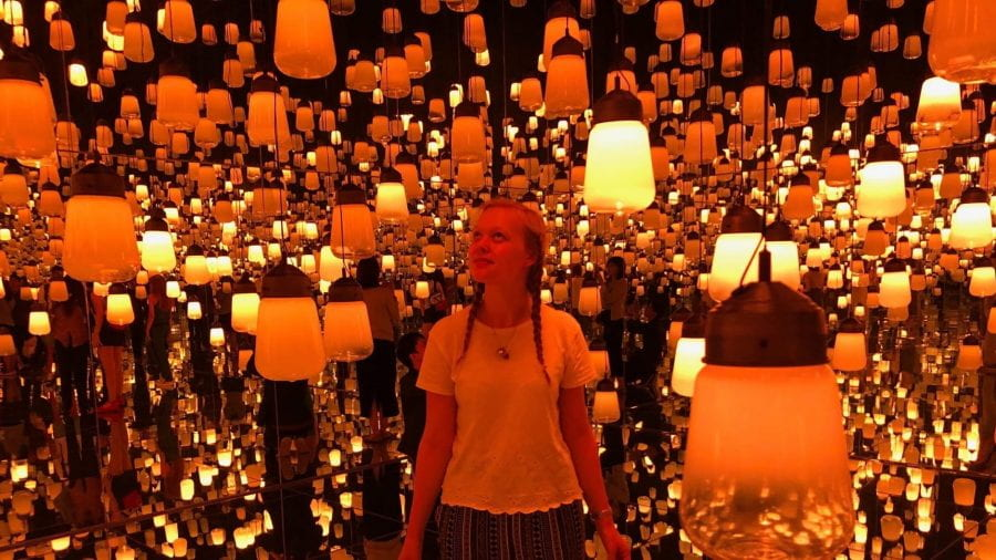 Female University of Lincoln student Beth Gulliver in the lantern room at TeamLab: Borderless.