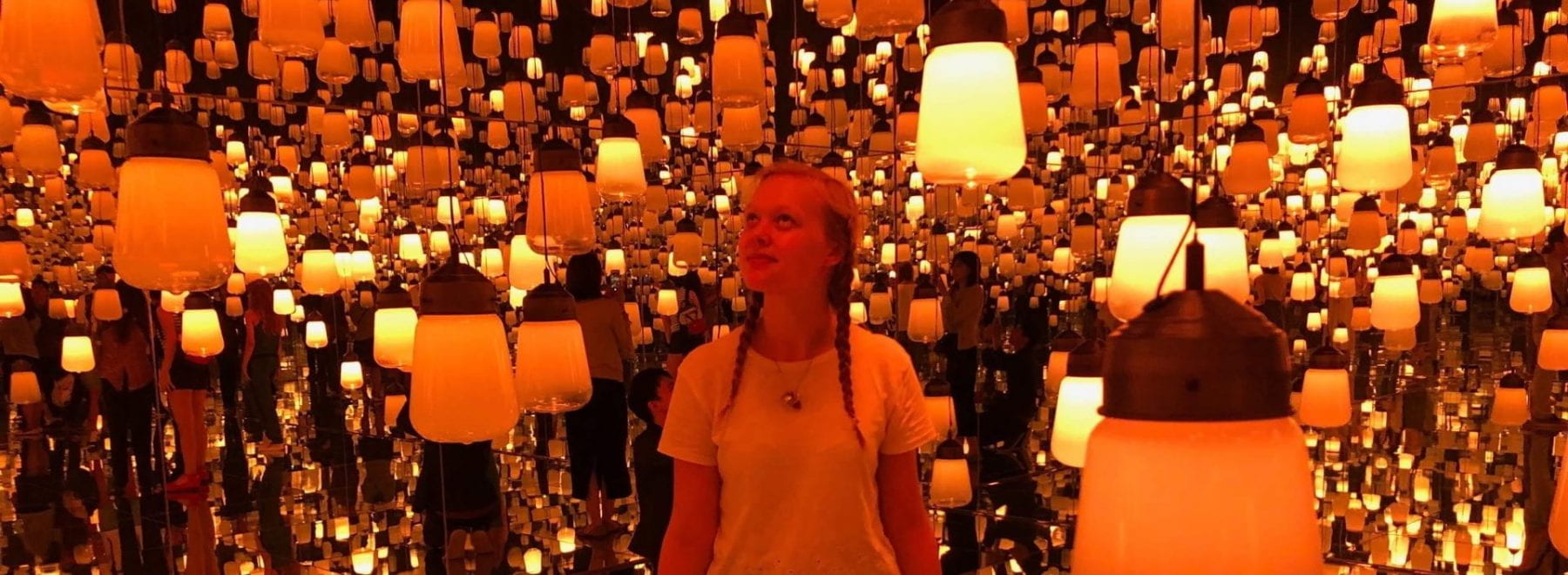 Female University of Lincoln student Beth Gulliver in the lantern room at TeamLab: Borderless.