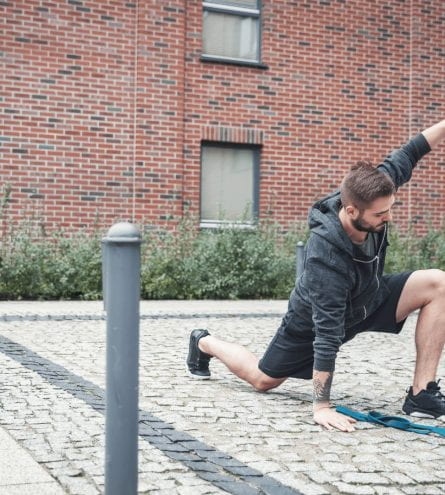 Man in sportswear exercising outside