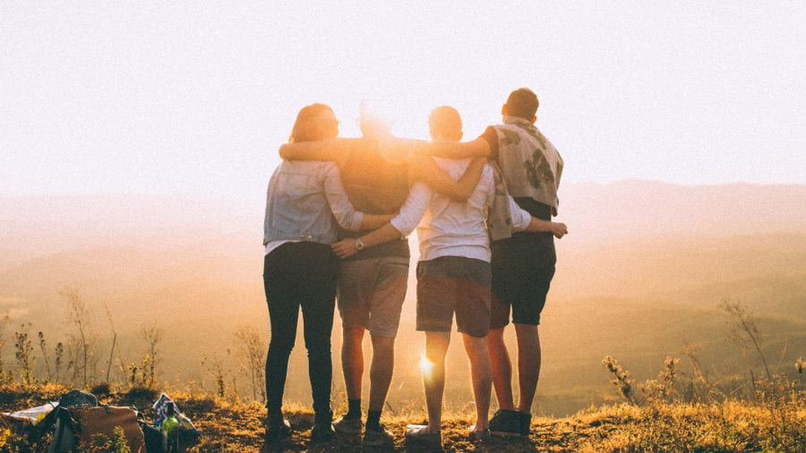 Friends stood on hill