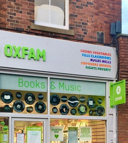 oxfam shop with 'book and music' in the window, next to a lush