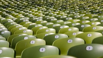 rows of green chairs that are all numbered