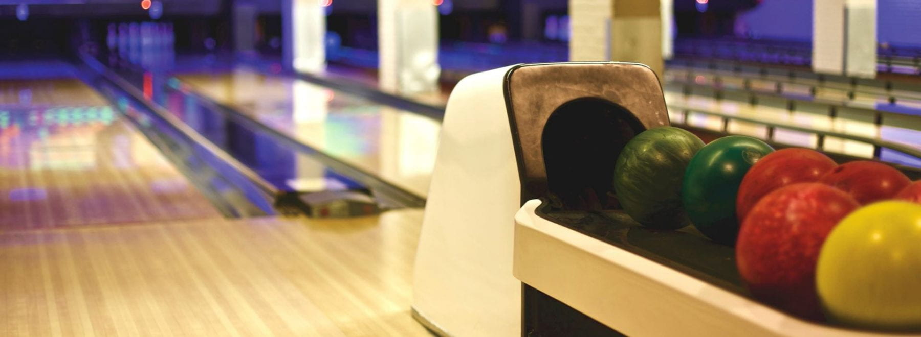 Bowling alley with bowling balls