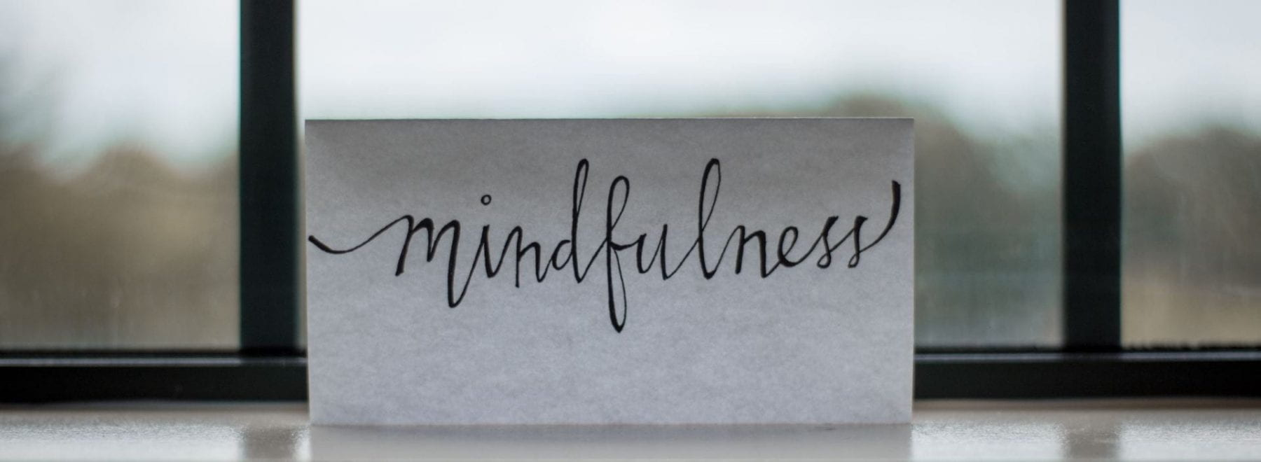 piece of paper reading mindfulness in calligraphy