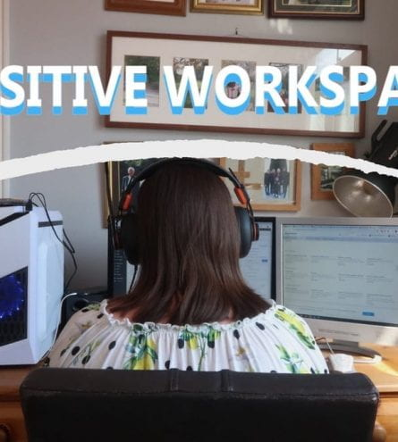 A girl sat at a computer, it reads: positive workspace