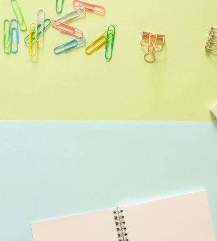 paperclips and paper scattered on desk