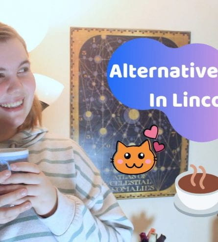 Thumbnail of a girl smiling holding a cup of tea. It reads: alternative cafes in Lincoln